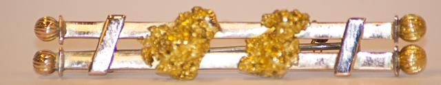 An Australian gold nugget bar brooch by Cornish