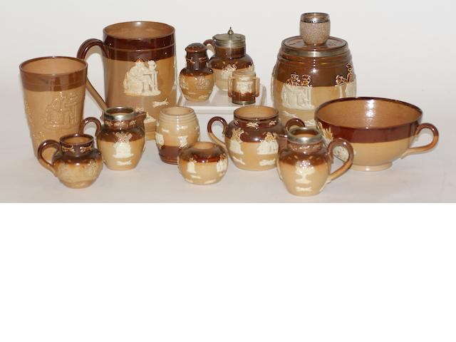 A collection of Doulton Lambeth brown salt glaze pottery with applied relief decoration
