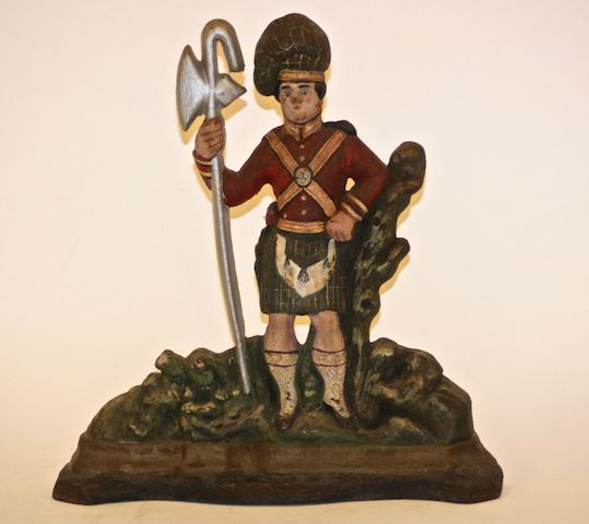 A Victorian painted cast iron doorstop of a Scots Guard