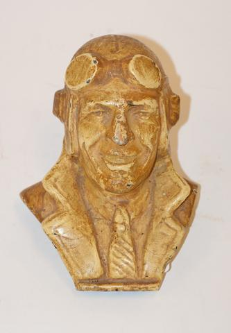 A painted cast iron bust of Sir Charles Kingsford Smith