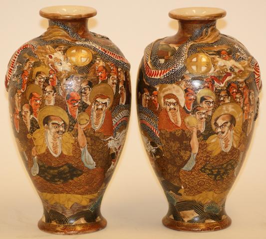 A pair of Japanese Satsuma vases, Meiji period, signed Dai Nihon Choshu Zan