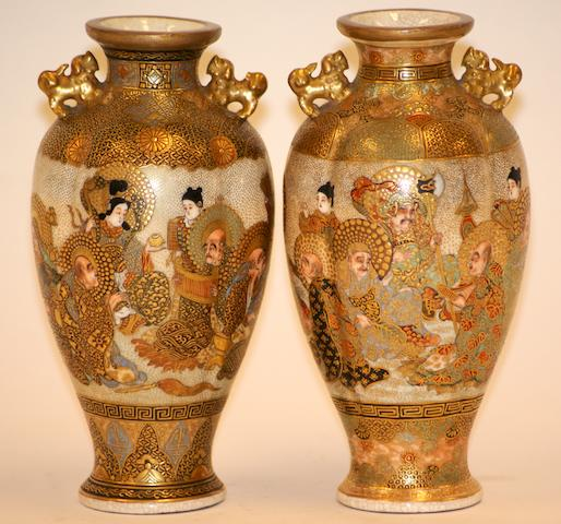 A pair of Japanese Satsuma fluted two handled vases, Meiji Period, signed Hatori Seizo