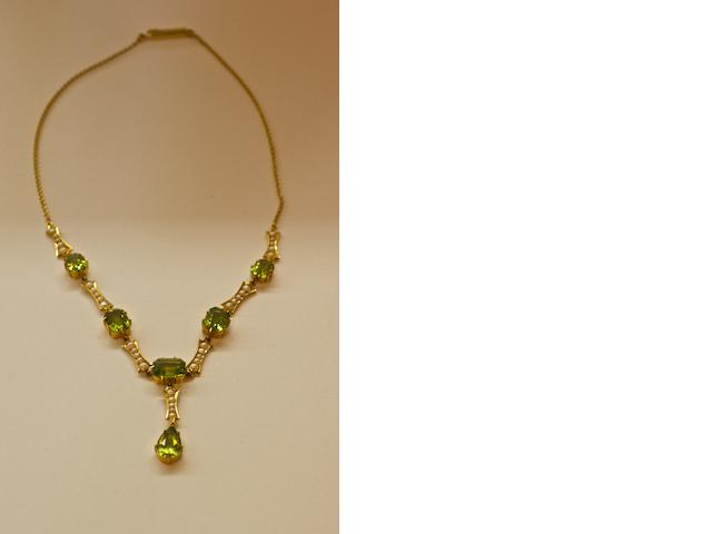 An Australian peridot and seed pearl necklace by Duggin, Shappere and Co, Little Collins Street, Melbourne, circa 1900
