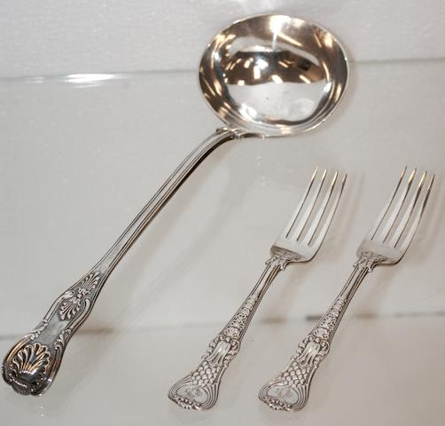 A Victorian silver Kings pattern soup ladle by George Adams, London 1874;  (3)