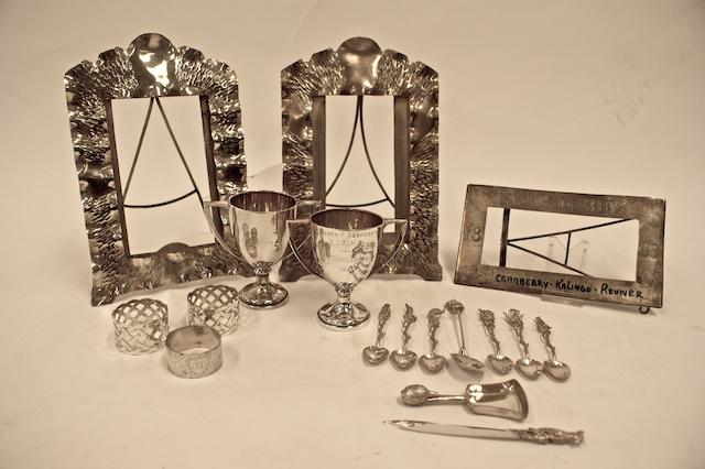 A collection of silver items comprising a pair of two handled trophy cups, marked 'WB/head/Silver'