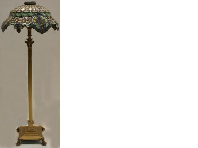 A lead light standard lamp with domed cover designed with flowerheads and leaves