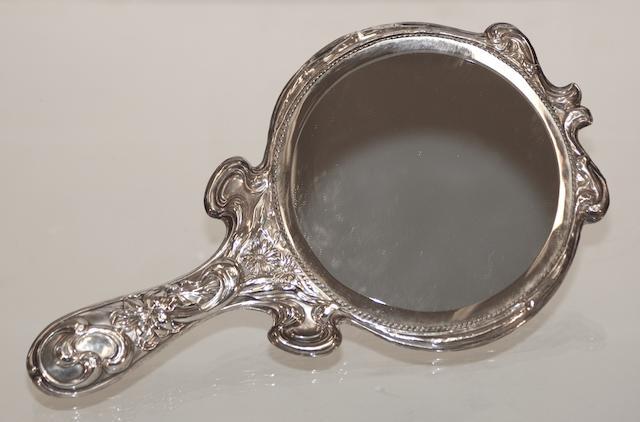 An Art Nouveau silver hand mirror by William Drummond Ltd Birmingham, 1909