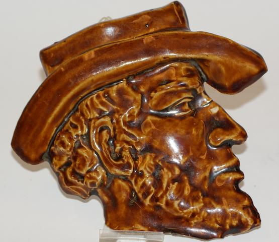 A brown glazed earthenware profile of John Batman