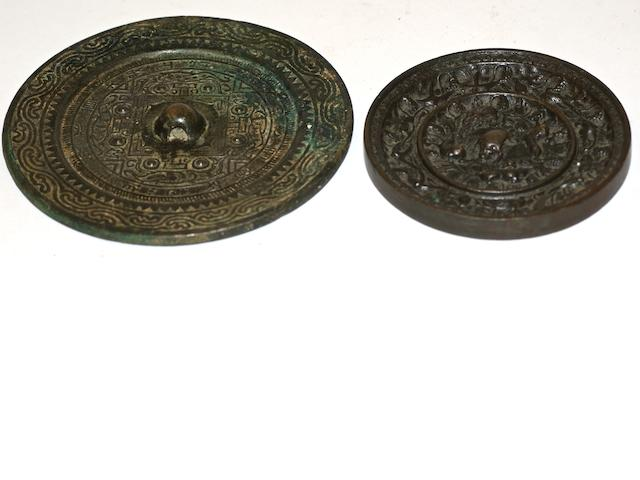 Two Chinese bronze circular mirrors, Ming dynasty