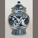 A Chinese blue and white porcelain baluster vase and cover, 18th century