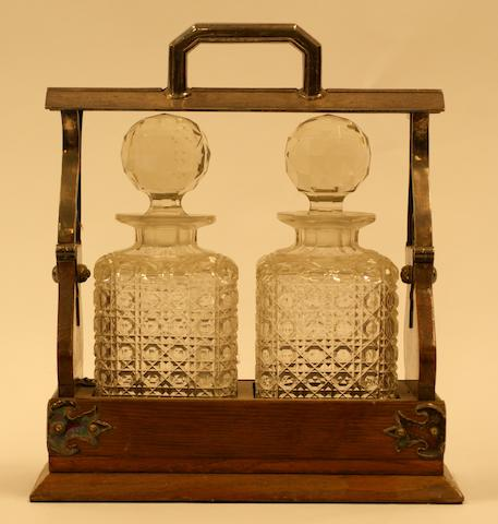 A Victorian silver plated mounted oak cased two decanter lockable tantalus