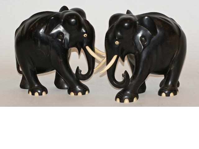 A pair of carved ebony and bone figures of elephants