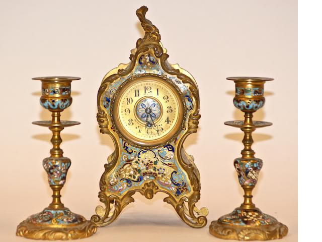A French gilt bronze and cloisonne enamel clock garniture