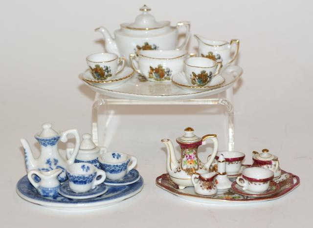 Four miniature porcelain tea sets