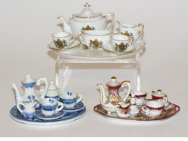 Four miniature porcelain tea sets