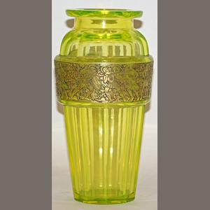 An Art Deco Moser lime green cut glass vase with a gilt band of Spartan warriors
