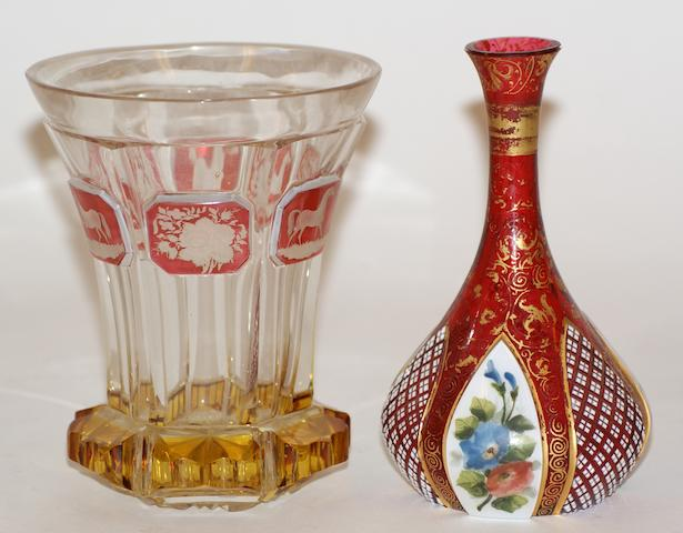 A 19th century Bohemian cut glass beaker with amber base and cranberry panels etched with horses and flowers