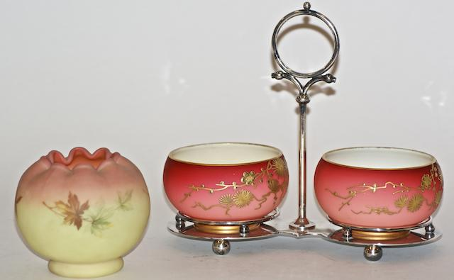 A silver plated mounted preserve stand with two Burmese pink glass bowls gilt with floral sprays