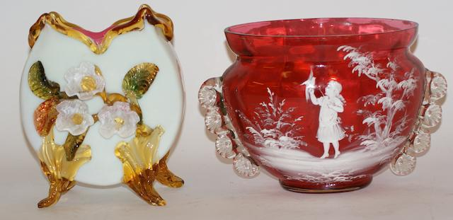 A Mary Gregory style cranberry glass bowl decorated with a young girl with a bird