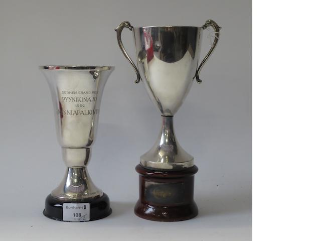 Two motorcycle trophies, awarded to Jim Redman,