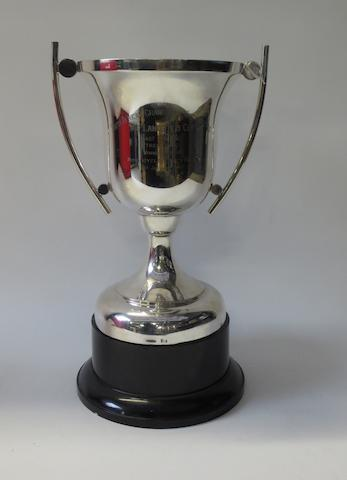 A 1960 Die Landstem Cup winning trophy awarded to Jim Redman,
