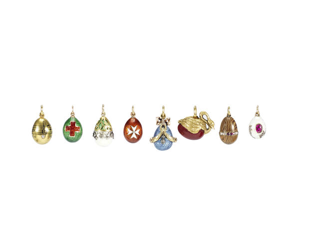 A gem-set wood miniature egg pendant and an enamel example