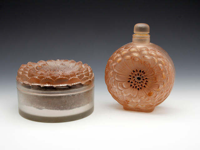 A René Lalique 'Dahlia' design cologne bottle with stopper and powder box and cover Circa 1931