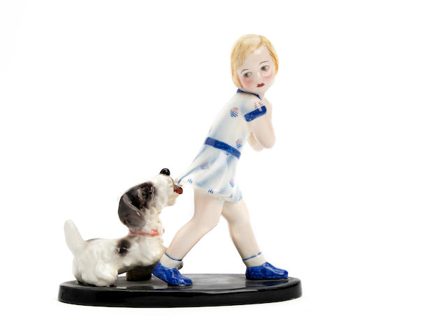 A Goldscheider figure of a young girl and dog Circa 1920-30