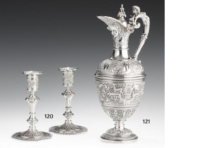 A pair of Victorian cast silver candlesticks by Brewis & Co, London 1897/98, with later French import marks  (2)