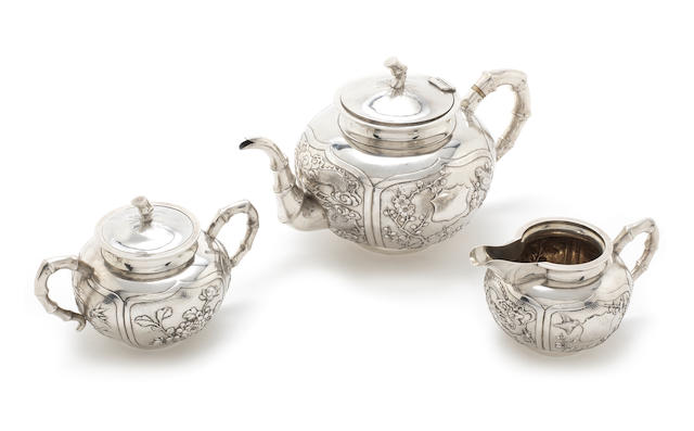 A late 19th/early 20th century Chinese export silver tea service by Wang Hing, also stamped '90' with character marks  (3)