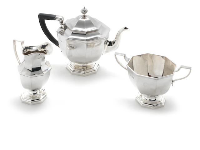 A three piece silver Art Deco three piece tea service by Mappin & Webb, Sheffield 1924  (3)