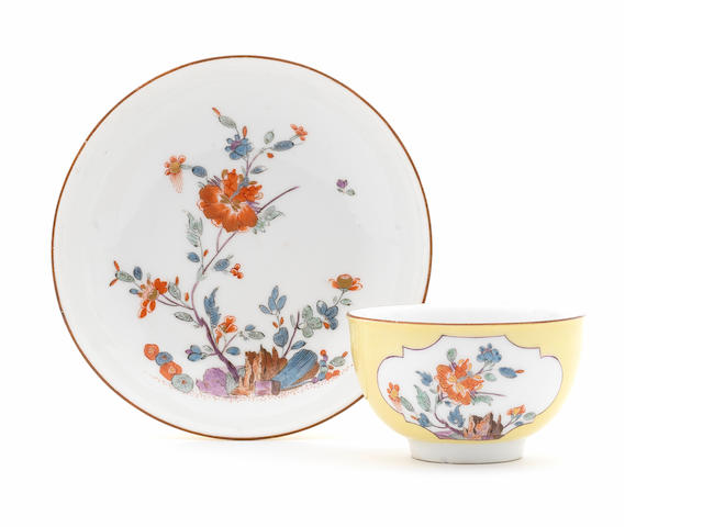 A Meissen yellow-ground kakiemon decorated teabowl and saucer (foot with rim chip, saucer with repaired rim chip)