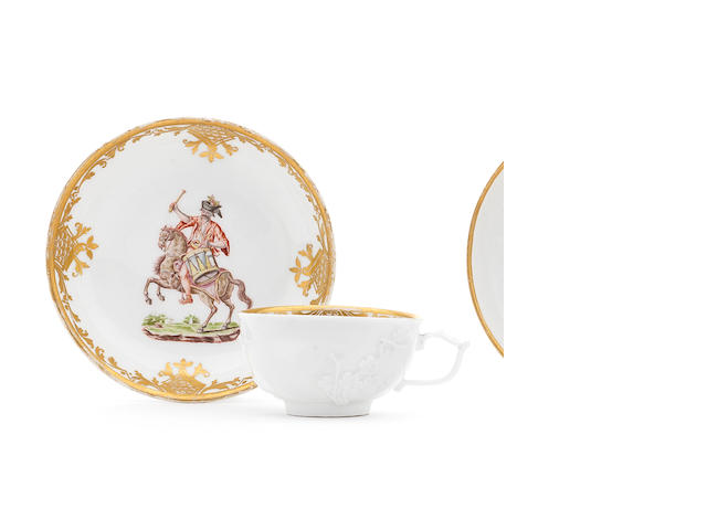 A Meissen Hausmalerei cup and saucer painted with drum majors in the manner of Mayer von Pressnitz