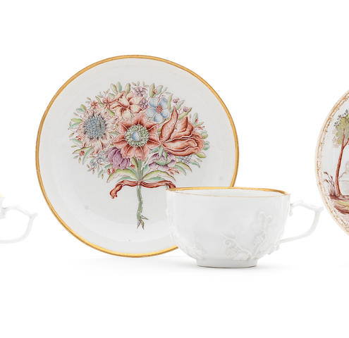 A Meissen Hausmalerei tea cup and saucer