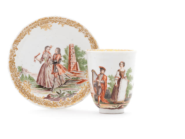 A Meissen Hausmaler beaker and saucer decorated in the manner of Mayer von Pressnitz