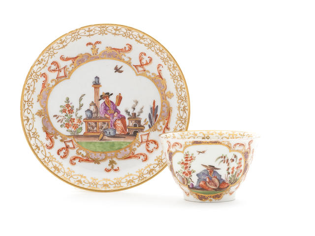 A Meissen teabowl with a chinoiserie figure looking at a large fruit and a later Punktzeit saucer with later chinoiserie decoration