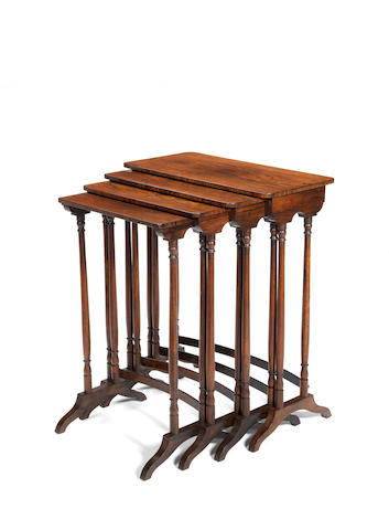 A nest of Regency rosewood quartetto tables of narrow proportions