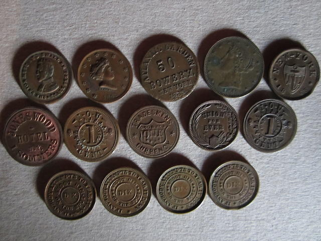U.S.A., a collection of 14 Civil War period tokens, including:  Jones Wood Hotel NY; Ed Schaaf Division St N.Y.; Knickerbocker Currency; Atlantic Garden Bowery NY.