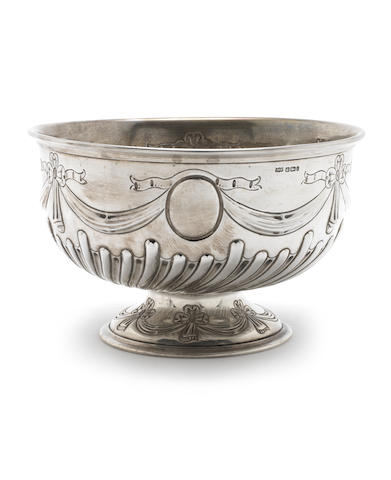 A silver rosebowl with flutes and swags