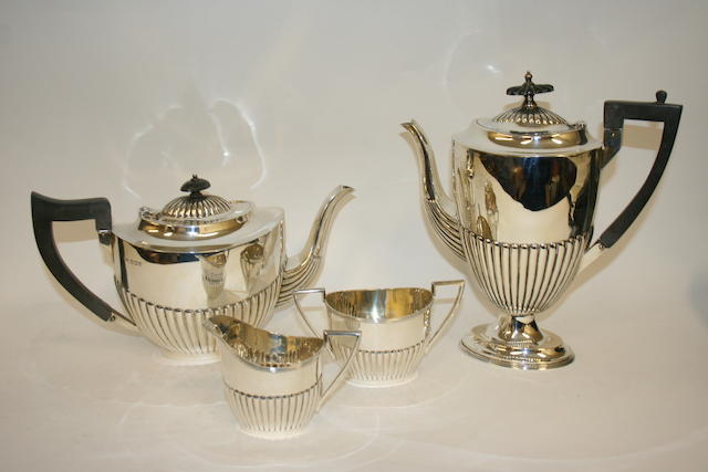 A silver four piece tea and coffee service by Walker & Hall, Sheffield 1919-1931  (4)