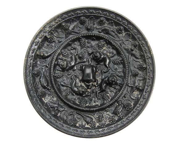 A Chinese Bronze 'beast and grapevine' mirror Probably Tang Dynasty