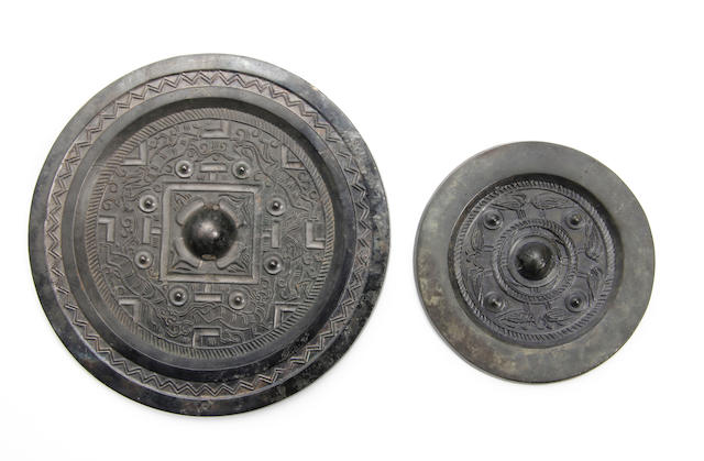 Two Chinese bronze mirrors  Han Dynasty