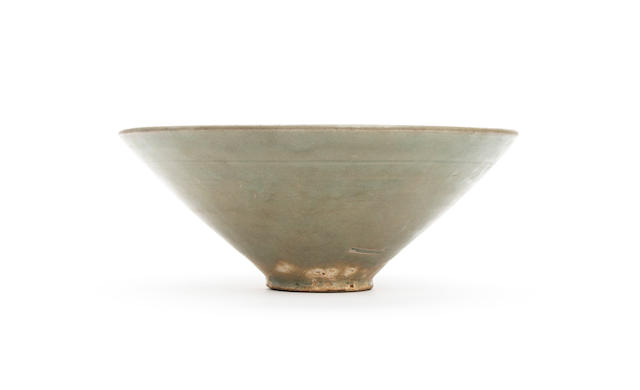 A Chinese celedon glazed conical bowl  Possibly Song Dynasty