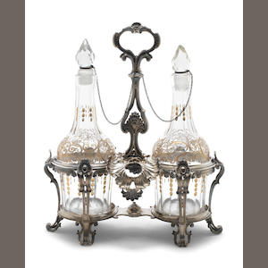 An 18th century Belgian silver oil and vinegar stand Maker's mark two hearts, unrecorded, for details of mark see Belgische Zilvermerken/Poinçons d'argenterie belges, by R. Stuyck, page 88 number 4902 Mons, date letter O