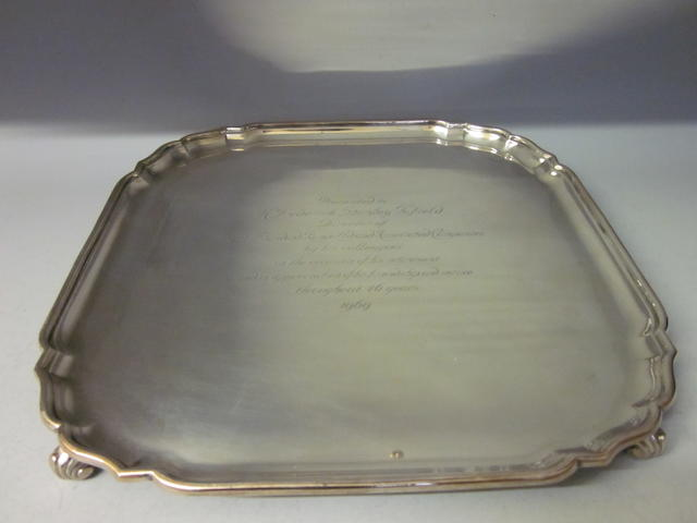 A square silver salver, by Garrard and Co. Ltd London 1964,