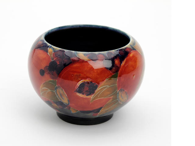 A small William Moorcroft 'Pomegranate' design bowl Circa 1915