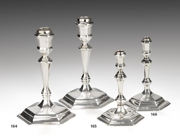 A pair of George I Britannia standard silver taper candlesticks, by James Seabrook London 1716  (2)