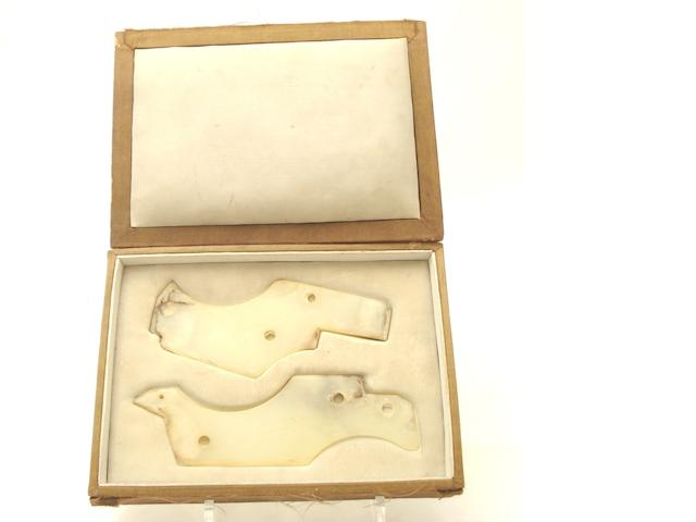 Two pieces of carved jade in presentation box