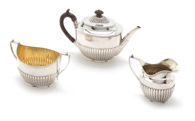 A Victorian silver three-piece tea service by Francis Boone Thomas, London 1884  (3)