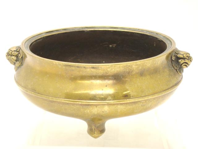 A bronze tripod censer Bearing Xuande sixteen character inscription but 19th century